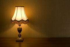 decorative lamp shade on a wood and brass table lamp